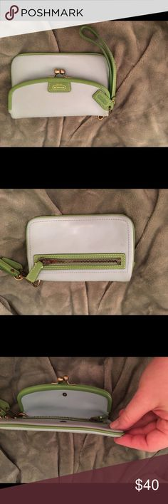 Coach vintage leather wristlet Light blue leather with green leather trim vintage wristlet with kisslock compartment. Zip pocket and slit pocket. Preowned in good condition from a smoke free home Coach Bags Wallets
