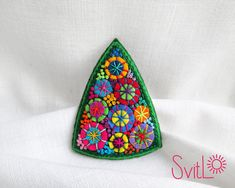 Christmas Tree Holiday Fireworks felt brooch. UNIQUE SINGLE COPY textile brooch by Svitlana Loniuk  Felt brooch based on filz imparting a convex shape and density. Hand applique. Hand embroidered.French knot.. Safety pin on the back side.  The brooch looks great on sweater, jacket, scarf, hat or purse. Be creative! Make your outfit unique and irresistible! Jewelry with a soul. Inspired by nature. Made with love. Measures: 6 x 7 cm / 2,4 x 2,8 inch  Real colors may slightly differ from d...