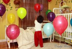 this 2 year old boy woke up on his birthday and saw his room full of balloons all around... what a neat idea! Can't imagine how excited this kid probably got!