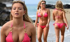 Zara Holland shows a serious amount of skin in a tiny pink bikini