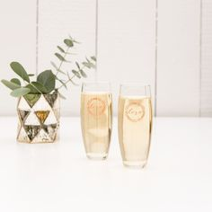 These cute personalized wine and champagne glass wedding favors are from The WeddingWire Shop and range from $1 to $10. Visit for more wedding favors that are sure to be a hit! Planning your wedding has never been so easy (or fun!)! WeddingWire has tons of wedding ideas, advice, wedding themes, inspiration, wedding photos and more. Personalized Champagne Flutes, Stemless Champagne Flutes, Personalized Wine Glasses, Toasting Flutes, Personalized Gifts, Wedding Favours Luxury, Custom Wedding Favours, Wedding Themes, Wedding Reception
