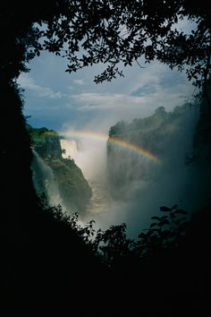 A rainbow arches over Victoria Falls in Zimbabwe.