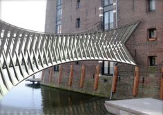 Inspired by movement, Robert van Embricqs presents award winning Furniture Design & Architecture. Bridges Architecture, Architecture Design, World Cities, Countries Of The World, Rickety Bridge, Bridge Construction, Bridge Design, Pedestrian Bridge, Walkway