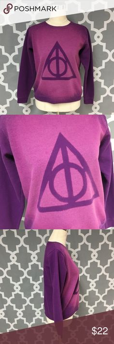Purple and Pink Ombre Deathly Hollows Sweater 🔘Description: Purple and Pink Ombre Harry Potter Deathly Hollows Crew Neck Sweater women's size small good used condition couple of spots as pictured, but not very noticeable    🔘Measurements:                 Pit to Pit: 20 inches                 Shoulder to Hem: 22 inches                                                        Inventory: C   If you have any questions please feel free to let me know!                                Thanks for…