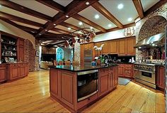 from blog Hooked on Houses - Nashville tv show - LOVE every little thing about this kitchen! brick, ceiling beams, floor, layout, cabs, etc. etc.