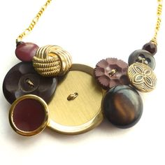 Brown Gold Brass Vintage Button Statement Necklace This necklace is a combination of shades of brown and brassy vintage buttons, with beads on gold colored wire. by buttonsoupjewelry, $32.00