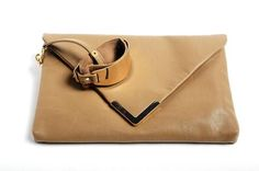 Aldo's minimalist Prezzo bag has a detachable wrist cuff and shoulder strap for versatility. In taupe, shown, or black. Aldo, multiple area locations, or aldoshoes.com.