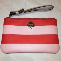 "kate spade striped bee wristlet kate spade striped bee wristlet in red & pink. one size, about 6.5"" x 4"". saffiano textured vinyl body, leather bow pull, navy lining with gold spade stud. good condition but signs of wear visible: small scratches on gold plated spade logo, light marks along bottom corners, and small scuff on leather bow. (see photos!) kate spade Bags Clutches & Wristlets"
