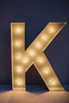 Decorate your reception location with a giant marquee monogram. #Whimsical #Wedding #monogram