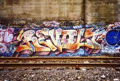 Revolt graffiti and train tracks