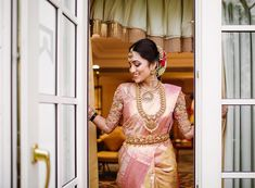 Styling your wedding outfit can be a task, especially when your heart's set on wearing a Pattu saree because, hey, the options are endless. So we decided to share some of our favourite styles of how to wear Pattu saree for marriage that you can try. South Indian Bride Saree, Indian Bridal Sarees, Kerala Bride, Hindu Bride, Indian Lehenga, Indian Gowns, Kerala Saree Blouse Designs, Bridal Blouse Designs, Wedding Dresses For Girls