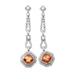 Stunning Mandarin Garnet Diamond Platinum Drop Earrings | From a unique collection of vintage drop earrings at https://www.1stdibs.com/jewelry/earrings/drop-earrings/