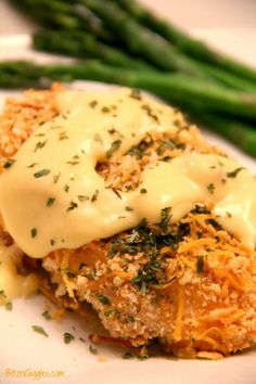 This Crispy Cheddar Chicken is scrumptious - flavorful and moist with a creamy sauce spooned over the top and garnished with parsley!  {BitznGiggles.com} #chicken #cheddar #crispy
