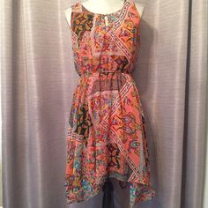 Paisley dress Multi patterned mix media paisley dress. Elastic, stretchy waistline.  Asymmetrical hemline. The sides of the dress are actually the longest. Keyhole neck line. Super cute and perfect for spring and summer. Worn once and washed. Delirious Dresses Asymmetrical