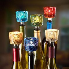 5 mosaic tealight holders http://hative.com/creative-wine-bottle-centerpieces/