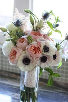 by Floret Cadet - www.floretcadet.com - Juliet garden roses, anemones, astilbe, thistle, tuberose and mint bridal bouquet wrapped in textured yarn