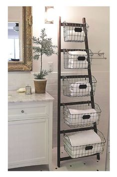 Who ever said ladders are for climbing? This stylish wooden ladder with wire baskets is cute, creative and perfect for those looking for extra storage. #storage #bathroom #livingroom #kitchen #modernfarmhouse #rustic #homedecor #wirebasket