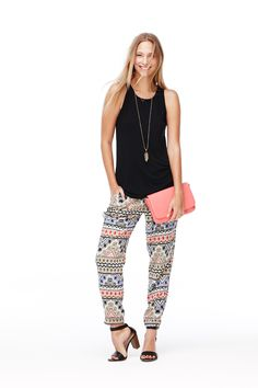 Step up the comfort level for date night in colorful printed soft pants from Old Navy. Dress them up for nighttime with black strappy heels, a black tank, and a cute pink clutch. Add your favorite necklace as a finishing touch.