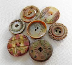 Delicate Carved MOP Buttons. $24.00, via Etsy.