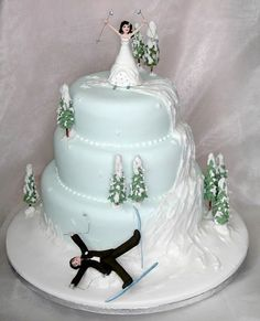 Hit the Slopes: For the bride and groom that love to ski and poke fun at one another, too. Brides, it's okay if this ski slope wedding cake is your favorite - you'd never really take your groom down on the slopes...right? | Creative Winter Wedding Cake Toppers for a Winter Wonderland Wedding