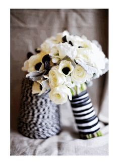 Silver dusty miller with creamy white roses, black-centered anemones and dark fiddlehead ferns... all tied together with black and white ribbon. #bouquet