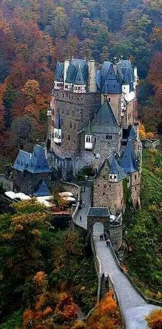Burg Eltz Castle by Alex Shar. Burg Eltz is a medieval castle nestled in the hills above the Moselle River between Koblenz and Trier, Germany. It is still owned by a branch of the same family that lived there in the century, 33 generations ago Places Around The World, The Places Youll Go, Places To See, Around The Worlds, Vila Medieval, Chateau Medieval, Medieval Castle, Beautiful Castles, Beautiful Buildings