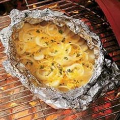 Campfire Potatoes Recipe - The onion, cheddar cheese and Worscestershire sauce combine to make a super side dish for any grilled meat. Plus, cooking in the foil makes cleanup a breeze.