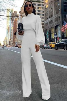 91%-99%polyester,1%-9%spandexBack Details: ButtonLeg Style: WideMaterial: Polyester, SpandexNeckline: Mock NeckOccasion: Daily, Date, Going OutPattern: Solid ColorSeason: Fall, SpringSleeve: Puff SleeveSleeve Length: Long SleeveStyle: CasualType: JumpsuitWaistline: High WaistShown Color: Black, White. $25.99