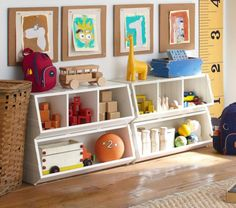 funky white storage units in child's room with featured art projects