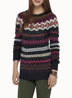 Exclusively from Twik     Zigzag and geo patterns arranged in horizontal stripes for a vintage boho look   Soft, stretch confetti knit with a touch of wool   Long style with an asymmetric hem and side slits   The model is wearing size small