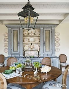 A Spanish colonial channels a bygone era with disparate patterns, fine antiques, and a sublime palette in a historic Dallas home. In the breakfast room, the vintage chairs are in a Penny Morrison fabric; 18th-century French Faience, Objets Plus; walls in Clunch, Farrow & Ball.