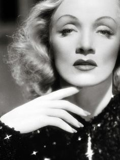 Marlene: the tell-tale butterfly shadow lighting effect invented for her by von Sternberg reduced her wide nose and enhanced her cheekbones.