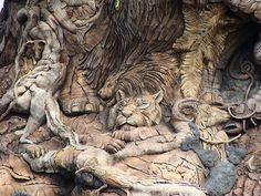 Animal Kingdom park - Disney's best kept secret a photo safari through Kilimanjaro and Asia Disney Animal Kingdom, Wood Sculpture, Sculptures, Wooden Cat, Tree Carving, Interactive Art, Wooden Animals, Tree Of Life, Installation Art