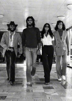 The Bee Gees pop group left to right: brothers Barry, Maurice and Robin Gibb with Barry's wife Linda as the group left London's Heathrow Airport for a tour of Canada. (August 1, 1974)