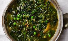 Spring greens soup with wild garlic pesto: celery, swiss chard, kale and peas