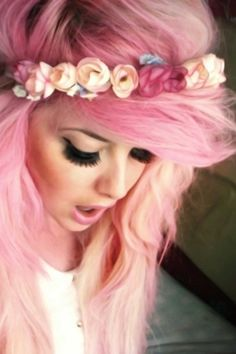 Pink hair, flowers, and big lashes. Love, love, love.