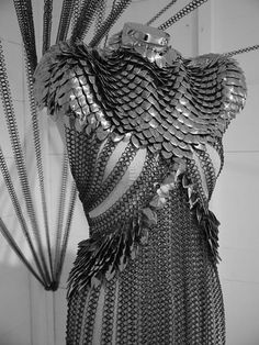 Chain mail and scale mail mix dress. much work in that.