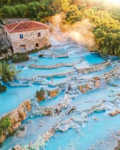 Hidden in the bucolic countryside of Maremma, these giant natural pools of swirling milky water draw visitors from all over. And there's a lesser-known hot spring just off the beaten path. Read about it at our link in bio! Toscana Italia, Best Honeymoon Destinations, Water Drawing, Destination Voyage, Nightlife Travel, Travel And Leisure, Travel Tips, Italy Travel, Bangkok