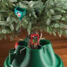 The Musical Christmas Tree Watering Reminder - Hammacher Schlemmer