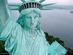 In the crown of the Statue of Liberty.  Dans la couronne de la Statue de la Liberté ~ A gift to the United States from France. Dedicated on October 28, 1886
