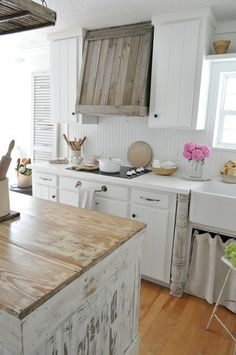 Farmhouse Kitchen Reclaimed Wood Hood. The reclaimed wooden vent hood was designed and built by my husband. Farmhouse Kitchen Reclaimed Wood Hood Ideas. Farmhouse Kitchen Farmhouse Kitchen DIY Reclaimed Wood Hood #FarmhouseKitchen #ReclaimedWoodHood #ReclaimedHood #DIYReclaimedWoodHood #DIYReclaimedHood #DIYHood Home Bunch's Beautiful Homes of Instagram @becky.cunningham.home