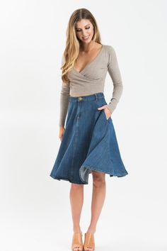 Denim skirts are a Fall uniform we'll never let go of! This classic look is revamped with a longer midi length and circle skirt silhouette! We love the sturdy denim material, and how easily this pairs