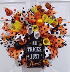 A personal favorite from my Etsy shop https://www.etsy.com/listing/461919858/deco-mesh-wreath-candy-corn-wreath
