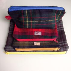 Our tartan collection of upcycled pouches!