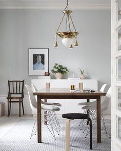 Beautiful white and light grey-blue dining room in the Finnish home of Maija Rasila.