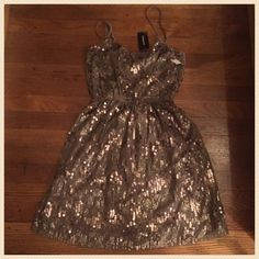 NWT: Express Sequined Mini-Dress Classic and fun; deep-v criss/cross top; adjustable spaghetti straps; elastic waist with straight skirt.  Had a belt, but it is with my missing socks. Express Dresses Mini