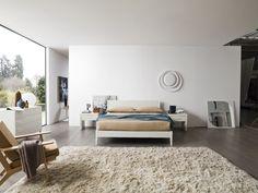 Simple egy egyszerű vonalvezetésű, minimál stílusú franciaágy. Letisztult, modern formájával tökéletes választás fiatalos hálószobákba. 100% olasz design, 100% olasz alapanyagok. A franciaágy elérhető hatféle laminált színben. Az ágy mérete: 169,5sz x 209,6mé x 89ma cm. Az ár a matracot nem, de az ágyrácsot tartalmazza. A matrac lehetséges mérete: 160x200 cm. Rugs, Simple, Bed, Furniture, Home Decor, Farmhouse Rugs, Decoration Home, Stream Bed, Room Decor