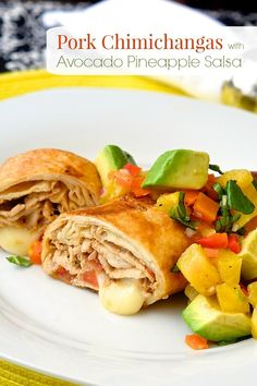Pork Chimichangas with Avocado Pineapple Salsa - turn leftover grilled or roast pork into a completely different and totally flavorful meal the next day. Your family will learn to love these leftovers!