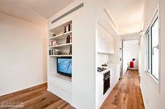 01-area-multiuso-central-define-apartamento-de-40-m2-em-tel-aviv