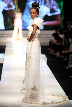 A model showcases designs on the runway by Valentino Napitupulu as part of IPMI Show 4 on day five of Jakarta Fashion Week 2009 at the Fashion Tent, Pacific Place on November 18, 2009 in Jakarta, Indonesia.